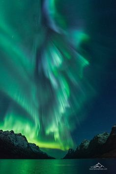 Amazing aurora at the beautiful fjord, Ersfjord in Tromso, Norway