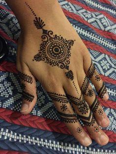 Henna hand tattoo
