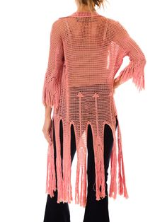 - Product Description - Measurements DETAILS This exquisite pink crochet original piece from 1920s has such a modern, festival bound, fun and hippy look! It has 3/4 length sleeves with fringe down to