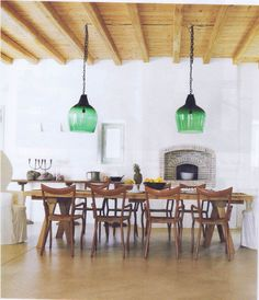 Love the ceiling and the pop of colour in the industrial sized pendant lights