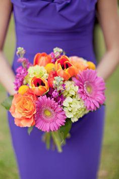 fuchsia and orange blooms, photo by Ivy Weddings http://ruffledblog.com/zilker-park-clubhouse-wedding #flowers #bouquet