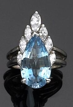 An aquamarine, diamond and platinum ring, Hammerman Brothers centering a pear-shaped aquamarine, crested with marquise-cut diamonds; marked HB, reference #15966; estimated aquamarine weight: 3.60 carats.