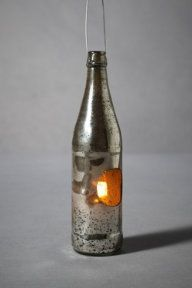 Awesome candle holder idea: Candle in a bottle! Brought to you by Shoplet.com - Everything for your business.