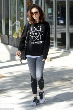 She's got chemistry! Lily Collins donned a statement top emblazoned with 'chemistry' after exiting the gym on Monday in Los Angeles