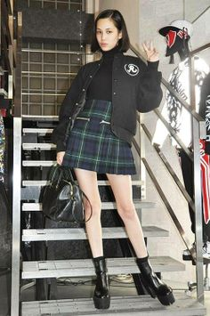 Kiko Mizuhara Varsity Jacket Black Turtle neck Plaid skirt Booties