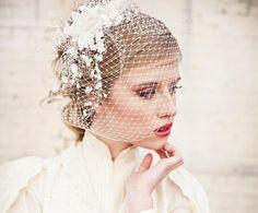 birdcage veil with vintage flower spray, modern veil, wedding headpiece. $95.00, via Etsy.