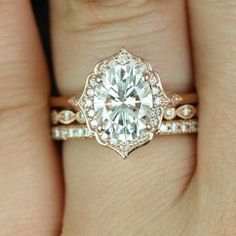 """The """"Mae"""" halo engagement ring, from Rosados Box on Etsy, showcases moissanite and diamonds and is set in 14k rose gold. (Diamond trio wedding set sold separately.)"""
