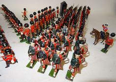 Lot 185 - * Britains Foot Guards firing, marching with pipers, at ease and at present with sentry box and H.