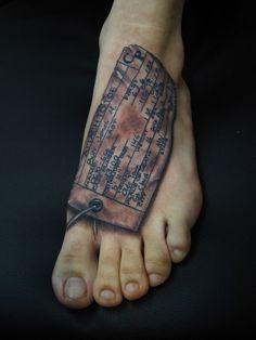 Toe tag black and grey foot tattoo :