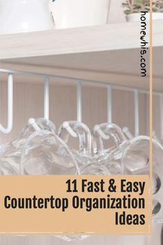 Love to let your dishes air dry over the sink? Want to keep your kitchen countertop clear and free of clutter at all times? Then here are 11 incredibly smart ways to organize your kitchen sink that will give you more storage space, eliminate clutter and ensure that your kitchen stays organized 24/7. Read the post now! #homewhis #countertoporganization #kitchenorganization #declutter #cabinetorganization #undersinkorganization #sinkorganization Kitchen Countertop Organization, Under Sink Organization, Kitchen Countertops, Kitchen Sink, Under Shelf Basket, Basket Shelves, Declutter, Organize, Cooking Utensil Holder
