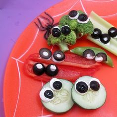 Olives and Googly-Eyed Crudites  -  cukes and broccoli - need to add some flavor to the cream cheese. worchestershire sauce and garlic salt would help. don't like how the other veggies look.