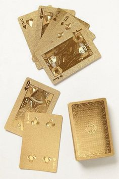 Gold-Dipped Playing Cards -- these would be awesome for poker night http://thestir.cafemom.com/food_party/165961/5_hostess_gifts_under_20http://thestir.cafemom.com/food_party/165961/5_hostess_gifts_under_20?utm_medium=sm&utm_source=pinterest&utm_content=thestir