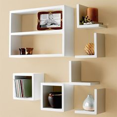 Modern display shelves that comes in 7 pieces , you can sort them the way you like to get the coolest display you wantDimensions ;Rectangular parts: 70 X 60Squared parts: 30 X 30 cmL shaped parts:30 X 30cm70*60 cm,