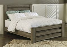 """The true rustic beauty of Vintage Casual style has never been brought to life more than with the warm relaxing design of the """"Zelen"""" bedroom collection. The warm gray finish features a stylish white wax effect beautifully complementing the replicated oak grain all surrounding the unique horizontal pocket details and wide pilasters adorning this rustic furniture."""