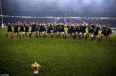 New Zealand's team performs the Haka with the Webb Ellis trophy as they celebrate after wi...