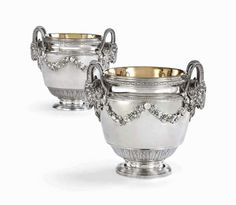 A LOUIS XVI SILVER WINE-COOLER FROM THE DUKE DE CADAVAL SERVICE AND A MATCHING WINE-COOLER THE FIRST WITH MARK OF ROBERT-JOSEPH AUGUSTE, PARIS, 1781, THE SECOND UNMARKED, PROBABLY MADE TO MATCH IN PORTUGAL, LATE 18TH OR EARLY 19TH CENTURY Price realised GBP 121,250.