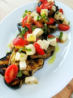 Chicken with Mustard and Herb Paste (I'd 86 the lemon) and grilled garlic tomatoes with cubed cheese! WOW!
