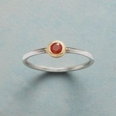 ONE IN A CARNELIAN RING--One small, faceted carnelian rimmed in 14kt gold vermeil turns a simple sterling silver band into something special. Handcrafted ring created exclusively for Sundance. Whole sizes 5 to 9.