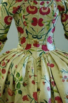 An embroidered satin open robe, Chinese made for the European market c.1770  Fabric created c.1755-60, embroidered in imitation of a brocade with bouquets of flowers tied with blue ribbons…