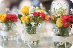 pretty spring centerpieces--want to find cheap glasses to hold buds and then some lace/burlap and ribbon