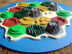 Custom 3D Settlers of Catan board, made from scrap plywood.