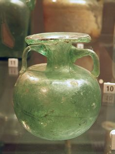 Collection of Ancient Roman glassware, perfume bottle, dating from the 1st/2nd century AD, Civico museo archeologico di Milano