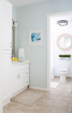 Another incredible makeover, proving how much difference paint color makes!! ~ Beachy Decor Master Bathroom // lilypad