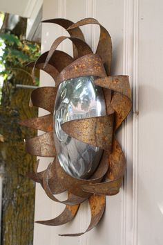 Rusted metal VW sunflower head by MyRustedRoots on Etsy, $69.00. My friend Tory made this.I love it!