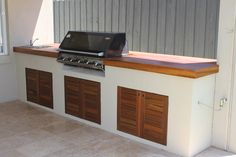 Renovated BBQ bench area with solid timber benchtop & cupboard doors