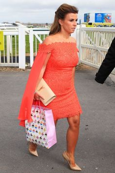 Coleen Rooney Wears A Bespoke Orange Cape Dress By Philip Armstrong To The Aintree Races, 2016