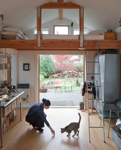 A single-car garage converted into a tiny house with a sleeping loft. | www.facebook.com/SmallHouseBliss