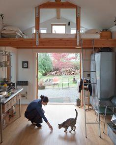 A single-car garage converted into a tiny house with a sleeping loft. | www.facebook.com/SmallHouseBliss