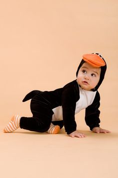 Baby Penguin The best for a baby to sport his black and white best this Halloween is as a cuddly baby penguin ($68). Adorable, no?