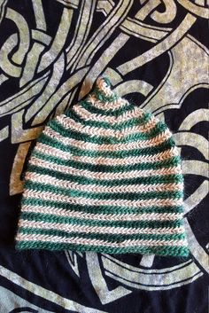 Loose knit stretchy all wool pointy hat. Finished size is 22 inches, fits any large adult head. I made this hat with a stretchy stitch which makes it extra soft and expandable. Vikings wore wool hats, sometimes a pointed hat. Wear this with the point straight up, folded over, or modern slouchy style. This is a spiraling, slightly conical hat. International shipping available