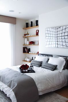 A beautifully sleek bedroom, complete with breakfast in bed for two.