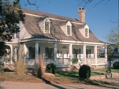 Love the stone accents, deep covered porch and all white exterior. Garrison Colonial Home Cape Cod  Country Style Home - houseplansandmore.com