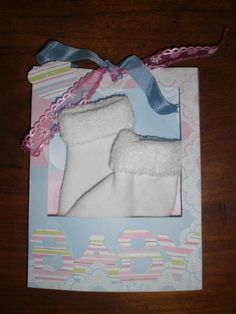 A Carla's Creation: card/box for newborn baby, with little babysocks.