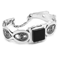 Beautiful bracelet in sterling silver and jet. Handmade in Galicia with traditional methods. Artcraf of The Way of St.James. Tax free $164.90