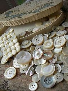 Old Mother of Pearl Buttons in a pretty Box.