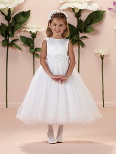 Sleeveless satin and tulle tea-length A-line dress with jewel neckline, satin bodice features wide waistband of three-dimensional flowers with beaded centers and satin tieback sash, covered buttons down back, full gathered multi-layer tulle skirt finished with wire edge, perfect for First Holy Communion and as a flower girl dress. Sizes: 4 – 14, 8 ½ – …