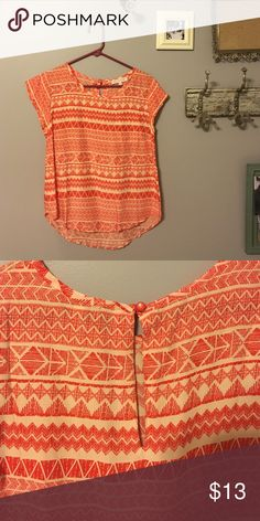 Orange & cream Francesca's blouse Orange & cream colored Aztec patterned Francesca's short sleeve blouse. Brand new only been tried on before. It's a size Small and runs true to size. Just doesn't get worn. Francesca's Collections Tops Blouses