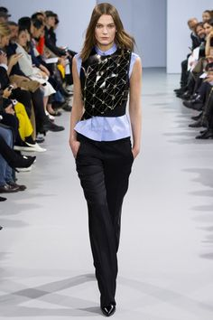 Gold linked leather vest makes fashion for the office.  Paco Rabanne Fall 2014 Ready-to-Wear Collection Slideshow on Style.com