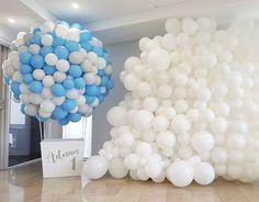 Organic hot air balloon sculpture set against beautiful white balloon wall  www.balloons.net.au