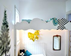 What a fabulous, simple way to make a loft bed something more.  Could expand the cloud theme with mobiles and/or 3D wall art.