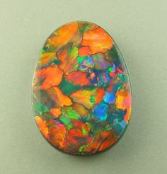 Unique in both composition and color, this 13.60 ct. black Opal from 100% Natural Ltd. is a truly magnificent specimen!