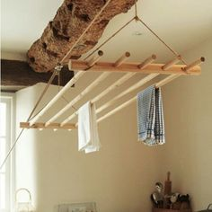 Drying rack in a laundry room with rustic elements.