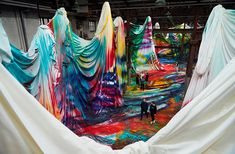 spray guns & suspended fabric: step inside katharina grosse's otherworldly color canvas www.designboom.com