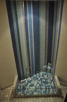 Bathtub resembling a waterfall, made with Bisazza tiles (Madrid, Spain).     Suitable for two! ;-)