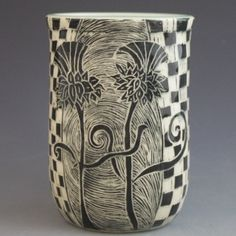 "Two Scottish Thistles dance on this stoneware mug. It was made on the pottery wheel, and then hand-etched in my woodcut technique.  I use non-toxic, food-safe glazes. Mugs are dishwasher and microwave safe. Color: Black/White/Celadon Green Dimensions: Approx 4.5""H x 4.5""W"