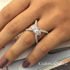 Gabriel NY - Preferred Fine Jewelry and Bridal Brand. 18k White Gold Round 3 Stones Engagement Ring. Two strands of criss crossing pave diamonds form the extraordinary band of this modern three stone engagement ring. Sparkling round cut diamond side stones are nestled securely at the juncture. Find your nearest retailer-> https://www.gabrielny.com/storelocator